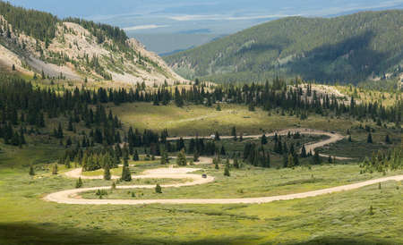 Series of bends on unfinished or dirt road climbing to top of Cottonwood Pass in Colorado Stock Photo - 31163563