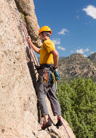 well equipped: Senior male climber well equipped with cams and caribiners on Turtle Rocks near Buena Vista Colorado