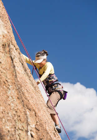 Senior female climber on rope assisted climb on Turtle Rocks near Buena Vista Colorado