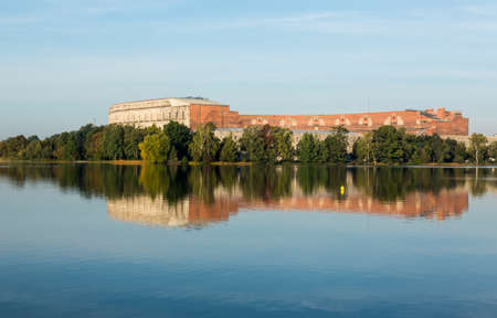 nuremberg: The remains of the large Congress Hall or Kongresshalle at the Nazi Parade grounds and reflected in still lake in Nuremberg, Germany Editorial
