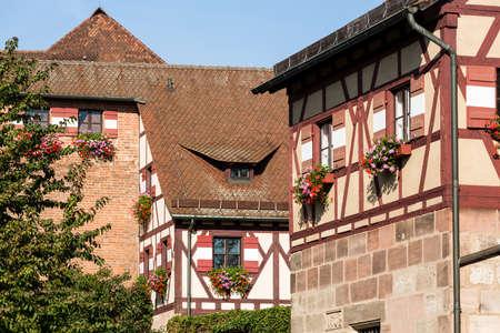 half  timbered: Flowers on half timbered windows on the Kaiserburg castle in Nuremberg, Germany Editorial