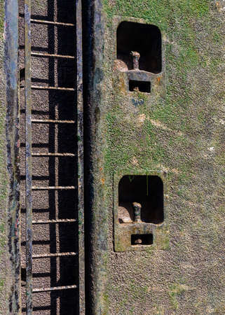 canal lock: Wet ladder and slimy surface of the canal lock on Rhine Main Danube canal in Germany, Europe