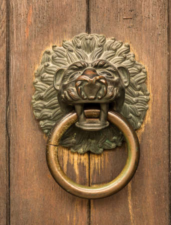 regensburg: Lion head knocker on the entrance door of St Jacob Monastery in the medieval town of Regensburg, Bavaria, Germany