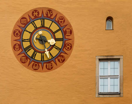 regensburg: Ancient clock face on wall in the medieval town of Regensburg, Bavaria, Germany