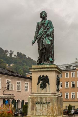 Statue of Mozart on cloudy rainy day in Salzburg Austria 新闻类图片