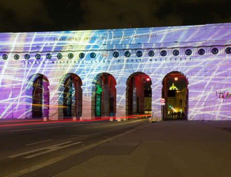 Illumination and light show on the ancient outer castle gate and arches in Heldenplatz, Vienna, Austria