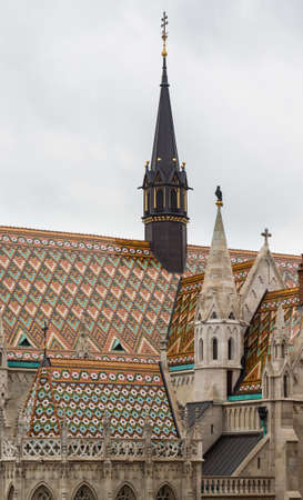 Detail of ornate carving and roof tiles on Mattias Church in Buda, Budapest, Hungary Redactioneel