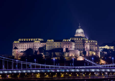 castle district: Night shot of the illuminated Buda Castle and Castle District in Budapest, Hungary Editorial