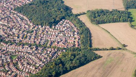 sprawl: Housing development sprawls near farmland near Luton, England Stock Photo