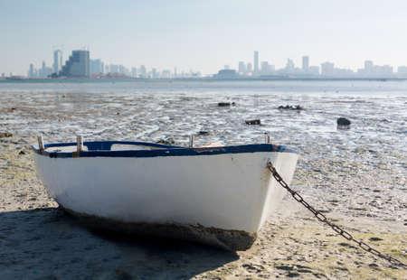 waterside: Fishing or fisherman boat on waterside overlooking Manama, Bahrain, Middle East Stock Photo