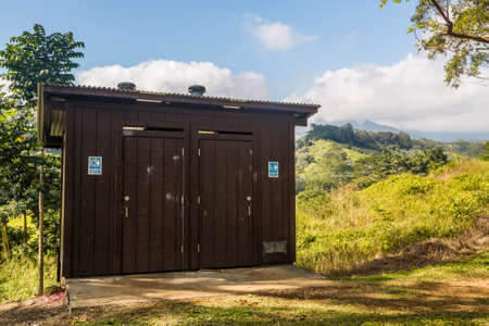 outhouse: Wooden restroom or toilet building in remote forest in Kauai forest