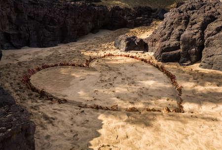 dug: Love symbol in shape of a heart dug into the sand of Kauai beach Stock Photo
