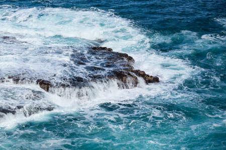 lave: Strong sea waves flow over lave rocks on edge of the shore near Lumahai Beach, Kauai, Hawaii Stock Photo