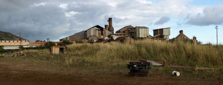abandoned factory: Panoramic view of old deserted sugar mill being overgrown by nature near Koloa, Kauai in Hawaii