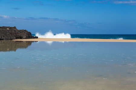 kauai: Waves crash onto Lumahai beach in background on Kauai Hawaii