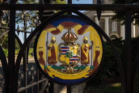 congregational: Painted Hawaiian royal seal on the cast iron fencing and gates at Kawaiahao Church in downtown Honolulu, Oahu, Hawaii