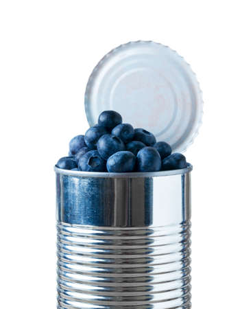 heaped: Blueberry fruit heaped inside opened tin can container in concept of fresh food coming in cans Stock Photo