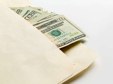 dollar bills: Stack of used $20 US currency bills or notes in an envelope in a concept photo for a bribe or payment Stock Photo