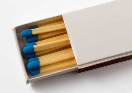 danger box: Small free hotel pack or box of matches with white background and blue tips to the match Stock Photo