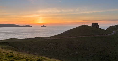 quin: Doyden Castle on headland overlooks the coast at sunset at Port Quin, Cornwall, England, United Kingdom