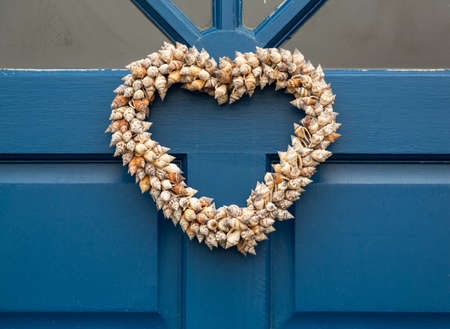cone shaped: Heart shaped front door wreath made out of cone shapes of sea shells