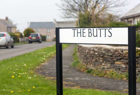 Funny humourous road sign for housing estate street called The Butts in Tintagel, Cornwall, England, UK