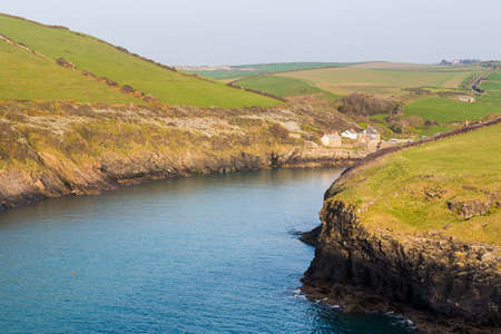 south west coast path: South West Coast Path along hillside above village of Port Quin, Cornwall, England, UK