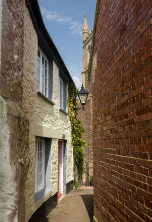 narrow street: Traditional narrow path or alley leading past old houses to the parish church in Fowey, Cornwall, England, UK Editorial