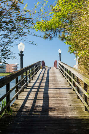 oc: Wooden pathway across pedestrian bridge to island off Ocean City, Maryland, USA