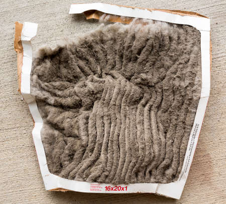 filters: HVAC air conditioning filter clogged with dust and dirt and falling to pieces after not being changed frequently