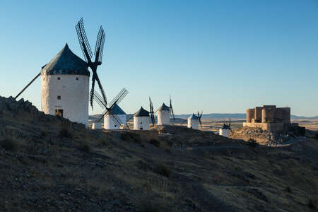 hilltop: Preserved historic windmills with castle on hilltop above Consuegra in Castilla-La Mancha, Spain Editorial