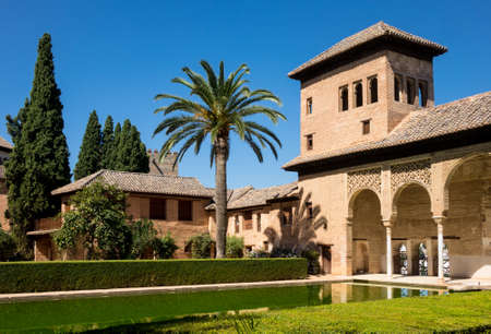 reflecting: Courtyard and reflecting pool of Partal in Alta Alhambra in ancient city of Granada in Andalucia, Spain, Europe Editorial