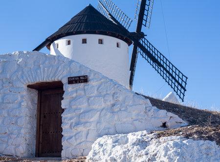 don quixote: Cave house or storage under historic windmills on plain above Campo de Criptana in Castilla-La Mancha, Spain