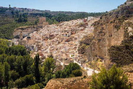 mancha: Overview of the hilltop town of Alcala del Jucar  in Castilla-La Mancha, Spain, Europe Editorial