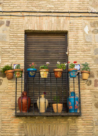 balcony window: Flower decked balcony window in narrow streets in ancient city of Toledo, Spain, Europe
