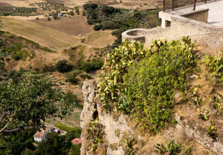 cliff face: Vertigo inducing view from the town down into the valley over the cliff face at Ronda, Andalucia, Spain