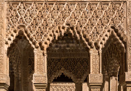 repeated: Repeated ornate carved arch in courtyard of Alhambra palace Granada, Spain