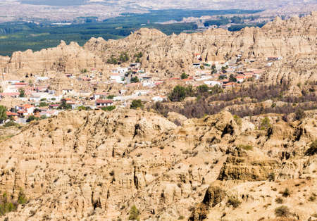 troglodyte: Numerous cave houses built into the hillside of small hill in Los Banos near Guadix, Andalucia, Spain Stock Photo