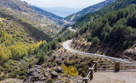 switchback: View down the winding A337 road from the Puerto de la Ragua mountain pass over the Sierra Nevada mountains in Andalucia, Spain Stock Photo