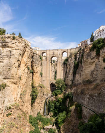 Puenta Nuevo and old town building over El Tajo gorge at Ronda, Andalucia, Spain Stock fotó - 47375329