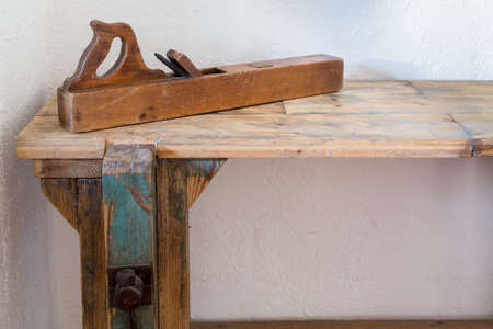 smoothing: Solid wood workers bench with wooden smoothing plane and large vise