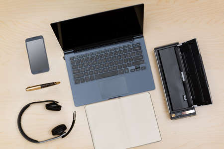 teleworker: Overhead view of many computing and smartphone screens to illustrate the concept of teleworking or working from home