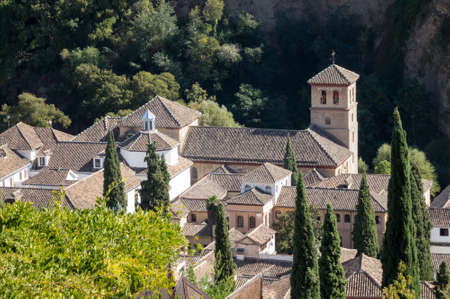 mirador: View of St Peter and St Paul church from Mirador San Nicolas in ancient city of Granada in Andalucia, Spain, Europe