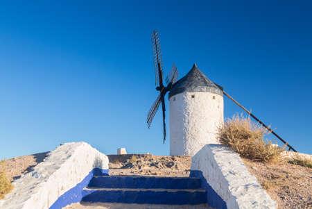 don quixote: Preserved historic windmills on hilltop above Consuegra in Castilla-La Mancha, Spain Stock Photo