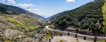 switchback: Panoramic high resolution image of the winding A337 road from the Puerto de la Ragua mountain pass over the Sierra Nevada mountains in Andalucia, Spain