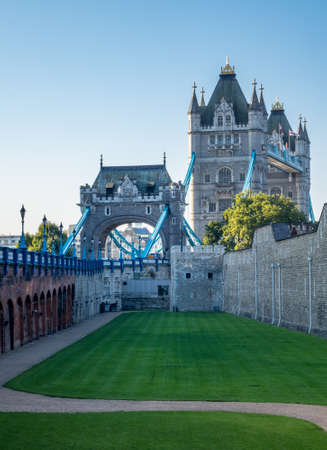 building exteriors: Juxtaposition of the Tower Bridge against the walls of the Tower in London, England, UK Stock Photo