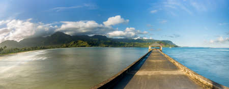 stitched: High definition stitched panorama of Hanalei Bay and pier at dawn with the Na Pali coast in the background near Hanalei, Kauai, Hawaii Stock Photo