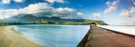 na: High definition stitched panorama of Hanalei Bay and pier at dawn with the Na Pali coast in the background near Hanalei, Kauai, Hawaii Stock Photo