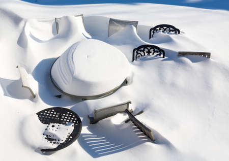 snow drift: Outdoor garden table and chairs buried by snow in deep drift during blizzard of January 2016 Stock Photo