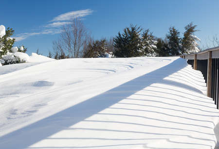 drifts: Snow in drifts cover deck and railings in modern house after blizzard of January 2016 in North Eastern USA